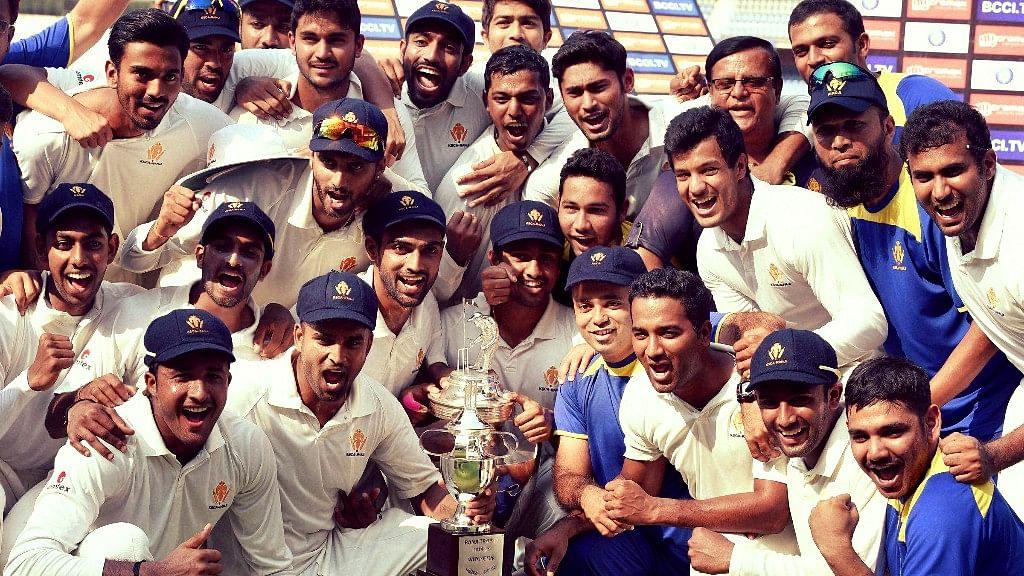 Karnataka players with the winners trophy after the 2014-15 Ranji Trophy season.