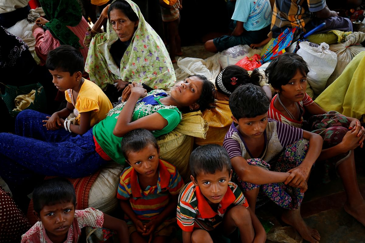 Newly arrived Rohingya refugees sit inside a shelter at the Kutupalang registered refugee camp, in Cox's Bazar, Bangladesh.