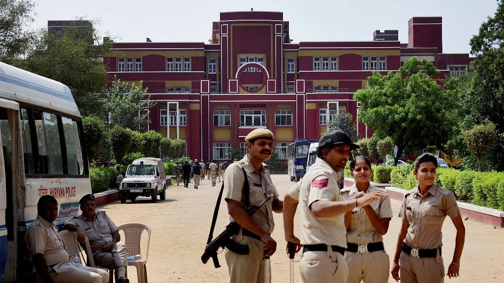 Police stand guard at Ryan International School during a protest, in Gurugram.