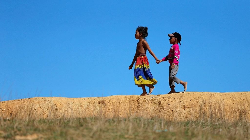 Rohingya children are seen as they walk near the Kutupalang Refugee Camp in Cox's Bazar.