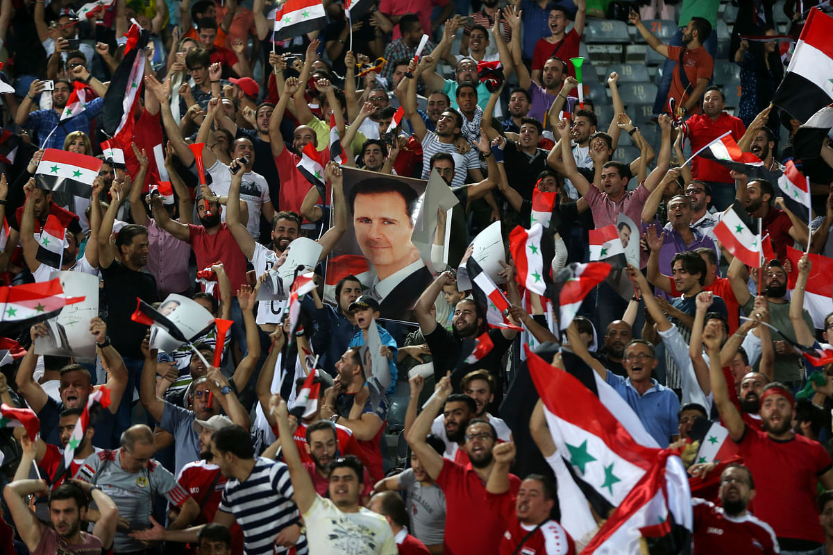 Syrian soccer fans celebrate  after their team scored a goal against Iran during their Round 3 – Group A World Cup qualifier