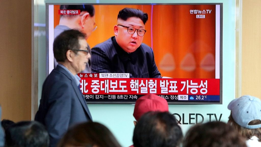 People watch a TV news programme showing North Korean leader Kim Jong Un at the Seoul Railway Station in Seoul on Sunday.