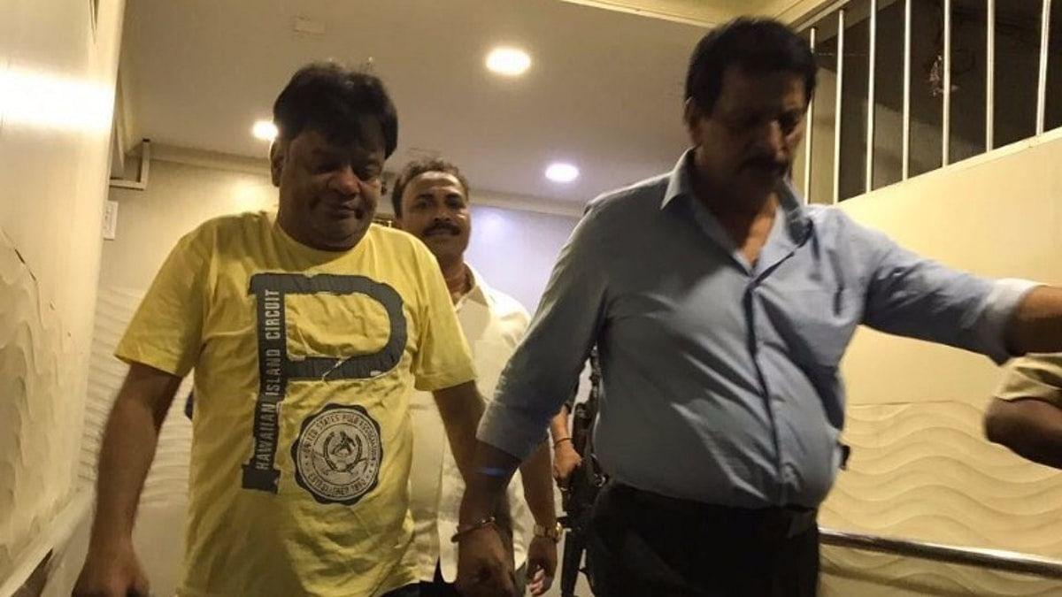 Dawood Ibrahim's brother Iqbal Kaskar (left) being taken by the Maharashtra police.