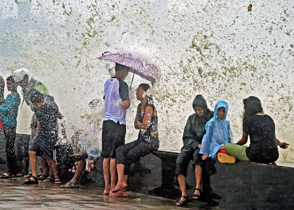Mumbai: People enjoying the high tide after heavy rains in Mumbai on Wednesday.
