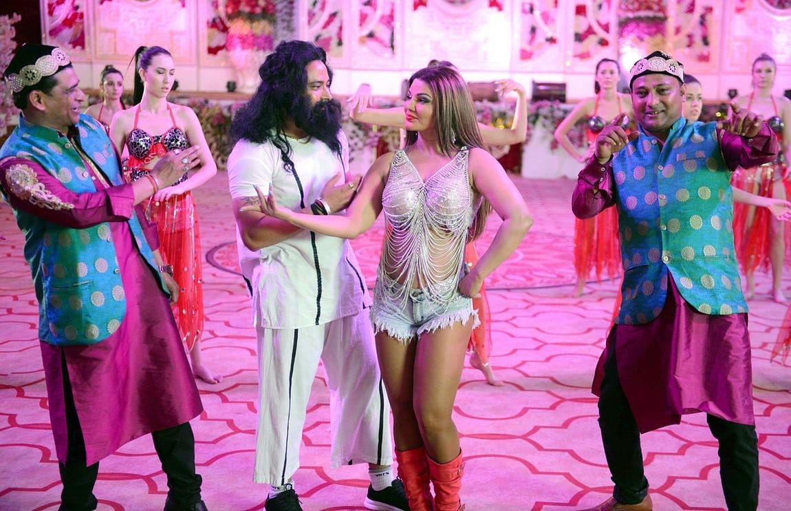 Rakhi Sawant as Honeypreet Insan and with the actor who plays Gurmeet Ram Rahim.