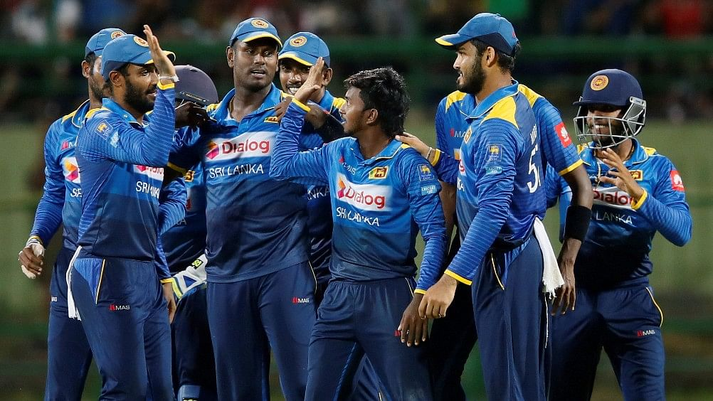 File photo of the Sri Lankan team celebrating a wicket during an ODI against India.