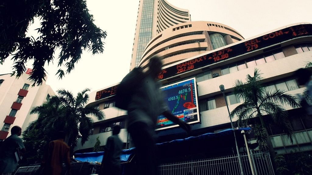 People walk pass the Bombay Stock Exchange (BSE) building displaying India's benchmark share index on its facade, in Mumbai. Photo used for representational purpose.