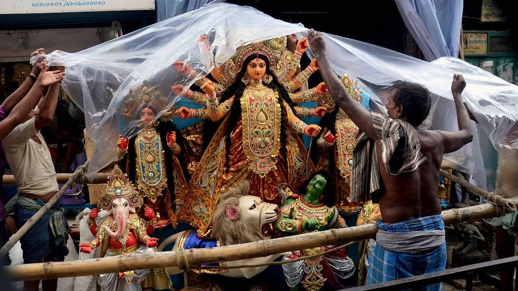 Many Hindus and Muslims across several puja marquees are working hard to make the five-day festival a success.