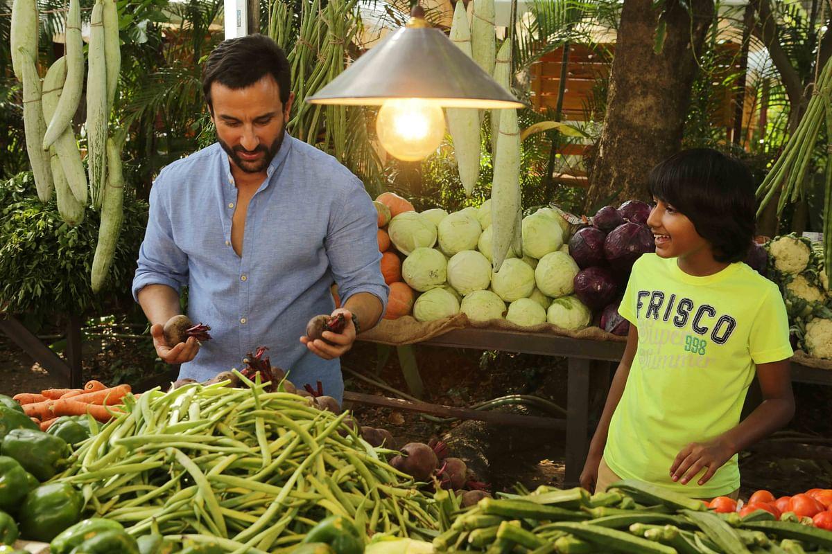 Saif Ali Khan with Svar Kamble in <i>Chef.</i>