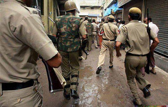 Policemen rush to Batla House during the encounter in New Delhi in September 2008.