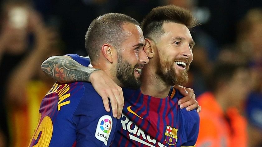 Barcelona's Lionel Messi celebrates a goal with Aleix Vidal.