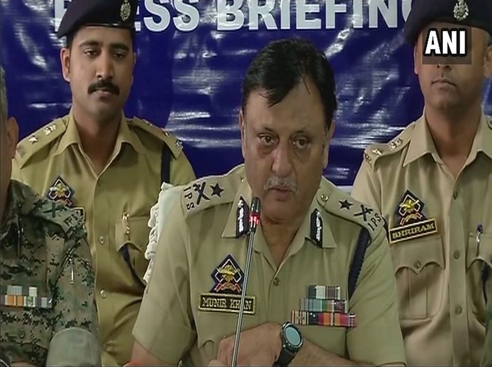 Heads of security forces in Kashmir address media while parading Hizbul militant Adil Dar