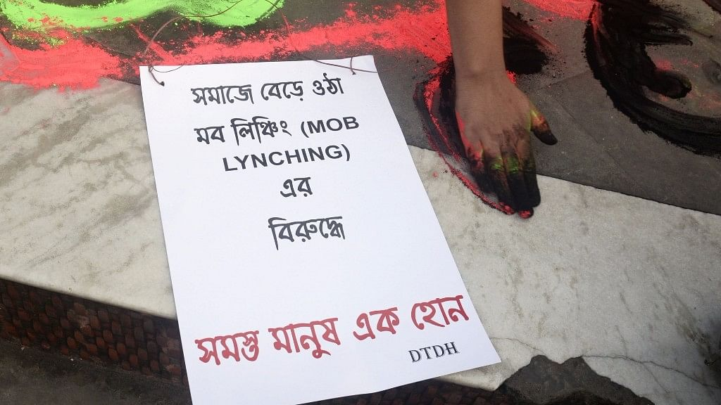 A poster during a demonstration against mob lynchings in Kolkata on 6 July 2017. The poster reads: 'Against increasing mob lynchings, Let us all stand together.'