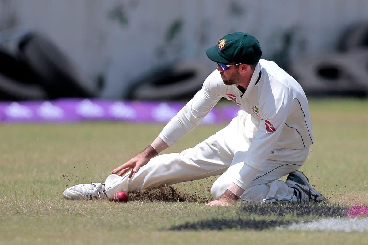 Glenn Maxwell fields the ball during a Test match.