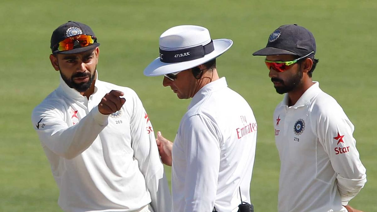Virat Kohli makes a point with an umpire during a Test match.