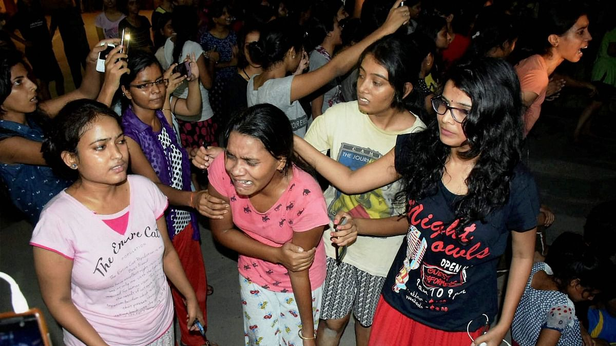 An injured student writhing in pain after police allegedly beat them up during a clash at Banaras Hindu University late Saturday night.