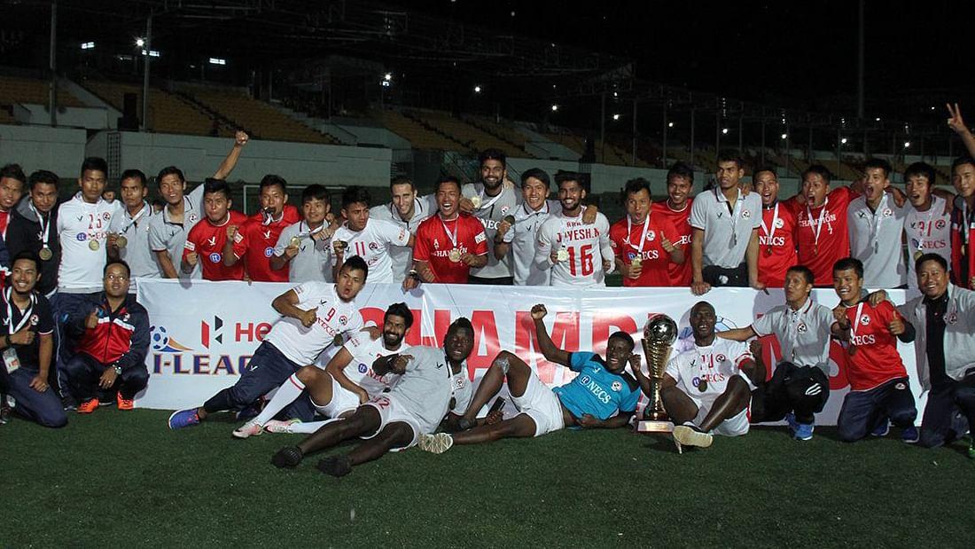 Aizawl FC team celebrate with the I-League trophy.