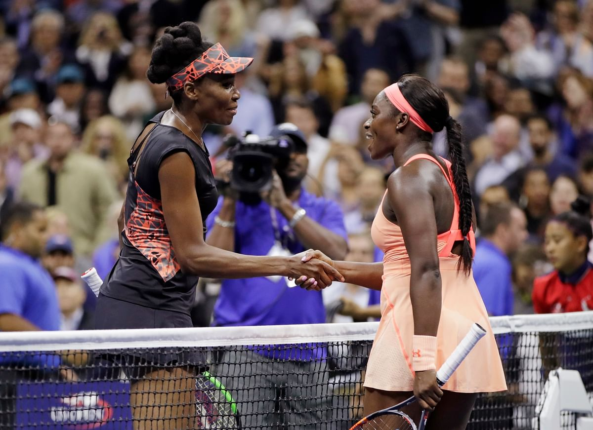 Venus Williams shakes hands with Sloane Stephens at the end of their US Open semi-final match.