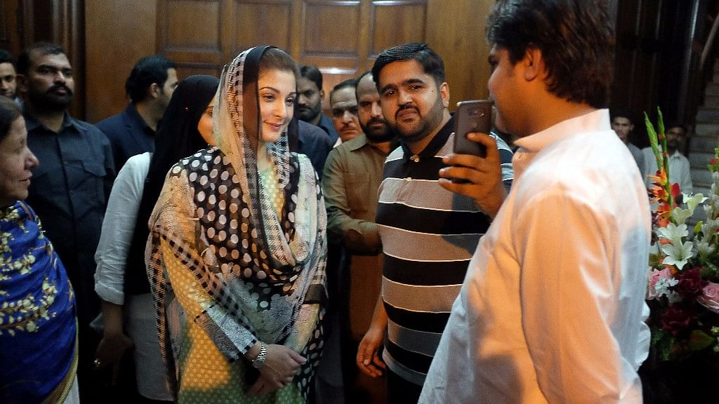 Maryam Nawaz, the daughter of Pakistan's former Prime Minister Nawaz Sharif, takes a picture with a supporter at a rally in Lahore.