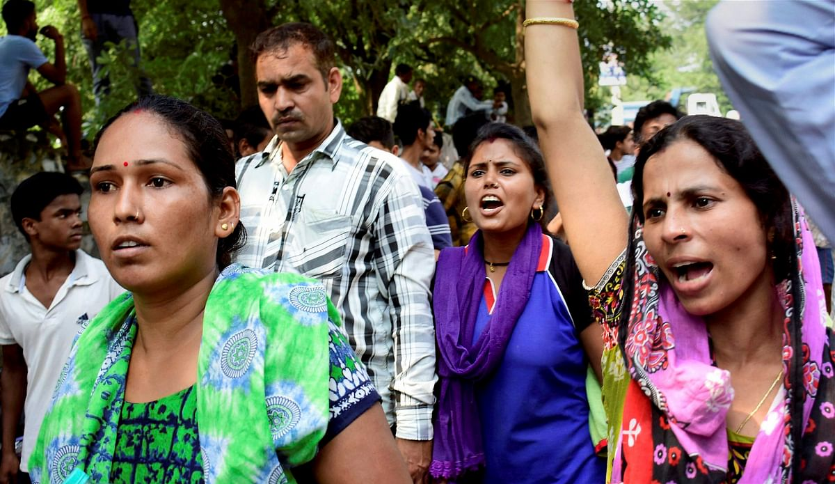 Demonstrators raise slogans during a protest outside Ryan International School as they demand action against the school, in Gurugram on Saturday.