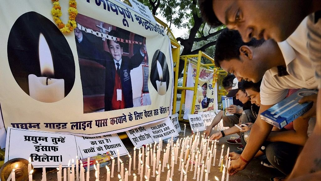 Students take out a candle march to pay tribute and demand justice for seven-year-old Pradyumn Thakur.