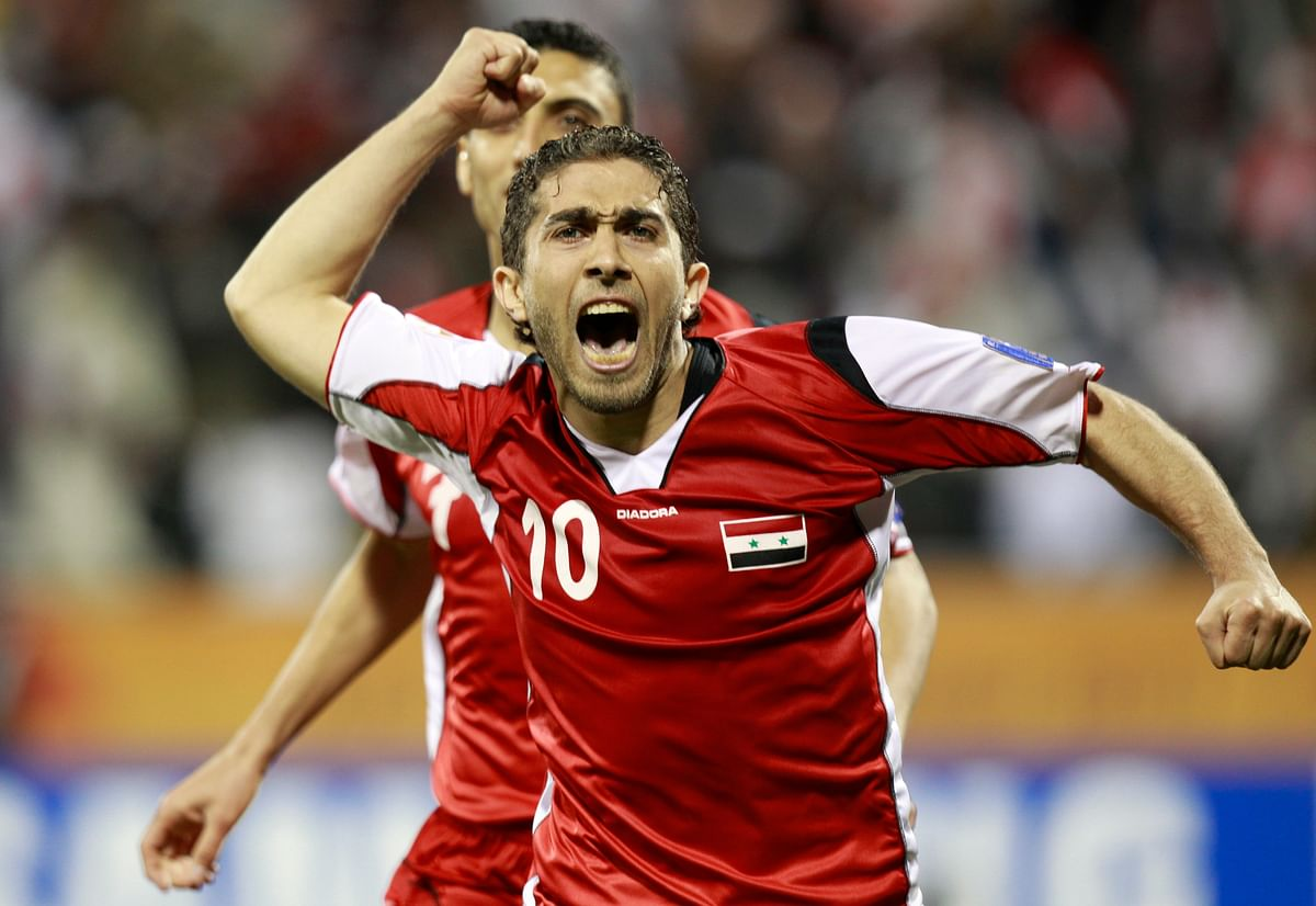 Syria's Firas Al Khatib celebrates his goal during a 2011 Asian Cup match in 2011.