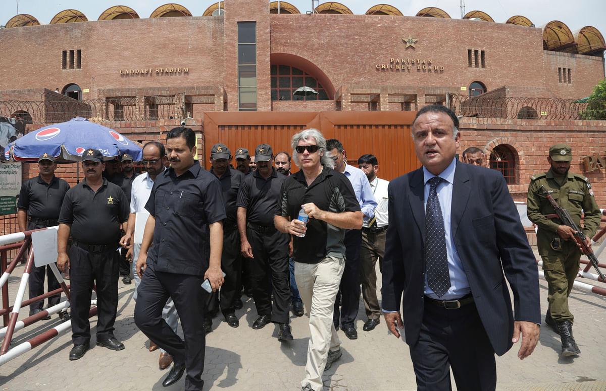 Members of the special security team of the International Cricket Council (ICC) visit Gaddafi Stadium in Lahore, Pakistan, Tuesday, Sept. 5, 2017, to review security arrangements for the World XI tour to Pakistan.