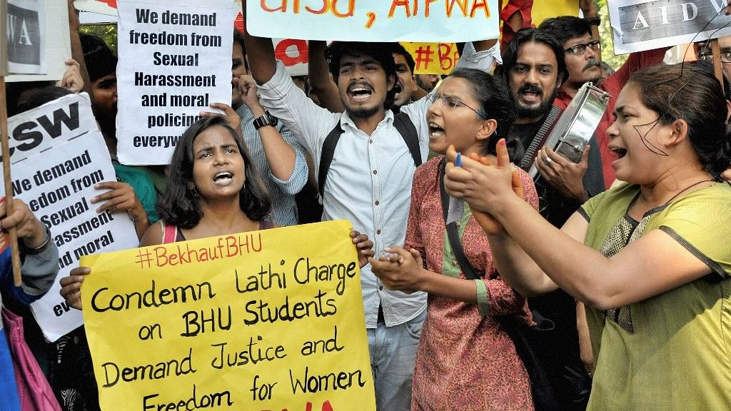 Members of AISA, AIWDA and KYS shout slogans against during a protest in support of Banaras Hindu University (BHU) girls' agitation, at Jantar Mantar in New Delhi on Monday.