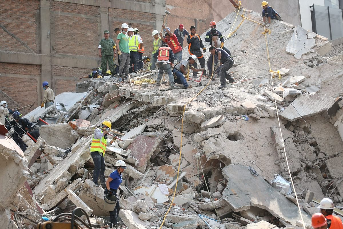 Mexico City : First responders work on removing the rubble of a collapsed building looking for survivors trapped underneath, after a 7.1 earthquake in Mexico City, Tuesday, Sept. 19, 2017. The earthquake stunned central Mexico, killing more than 100 people as buildings collapsed in plumes of dust.