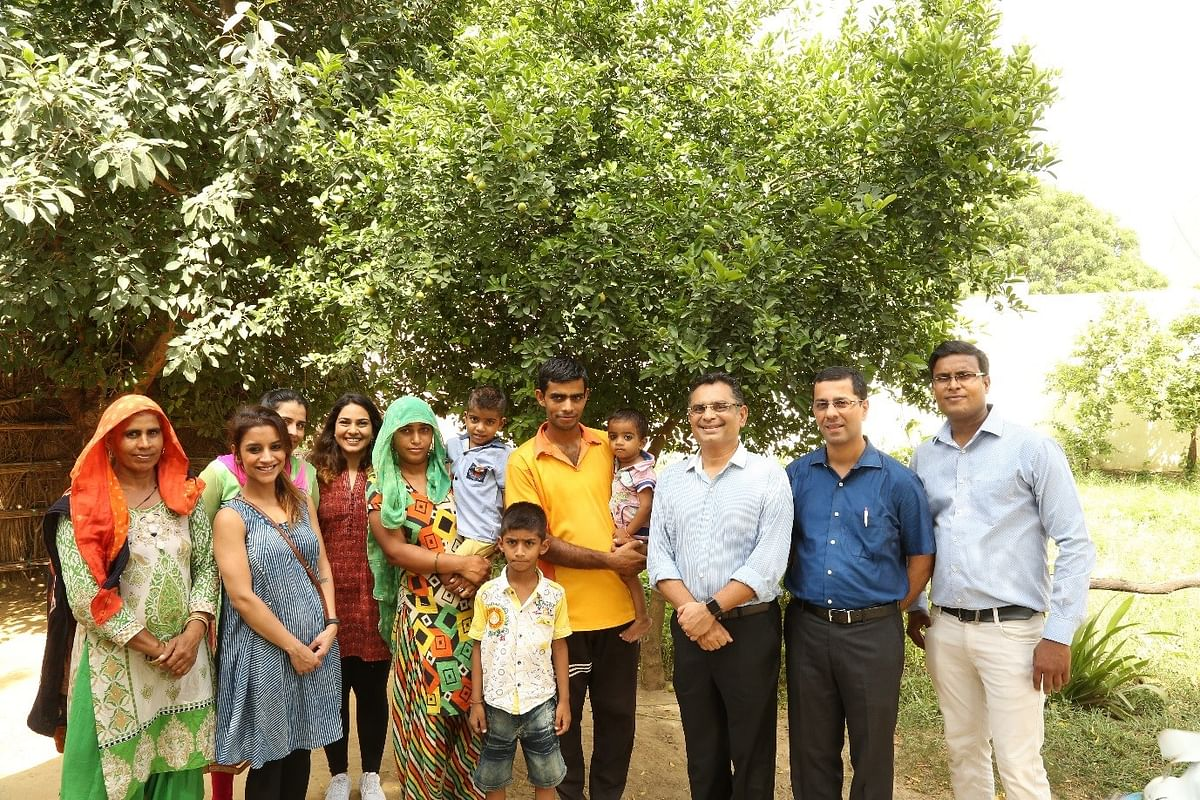 Anjali and her family with the Genesis Foundation team.