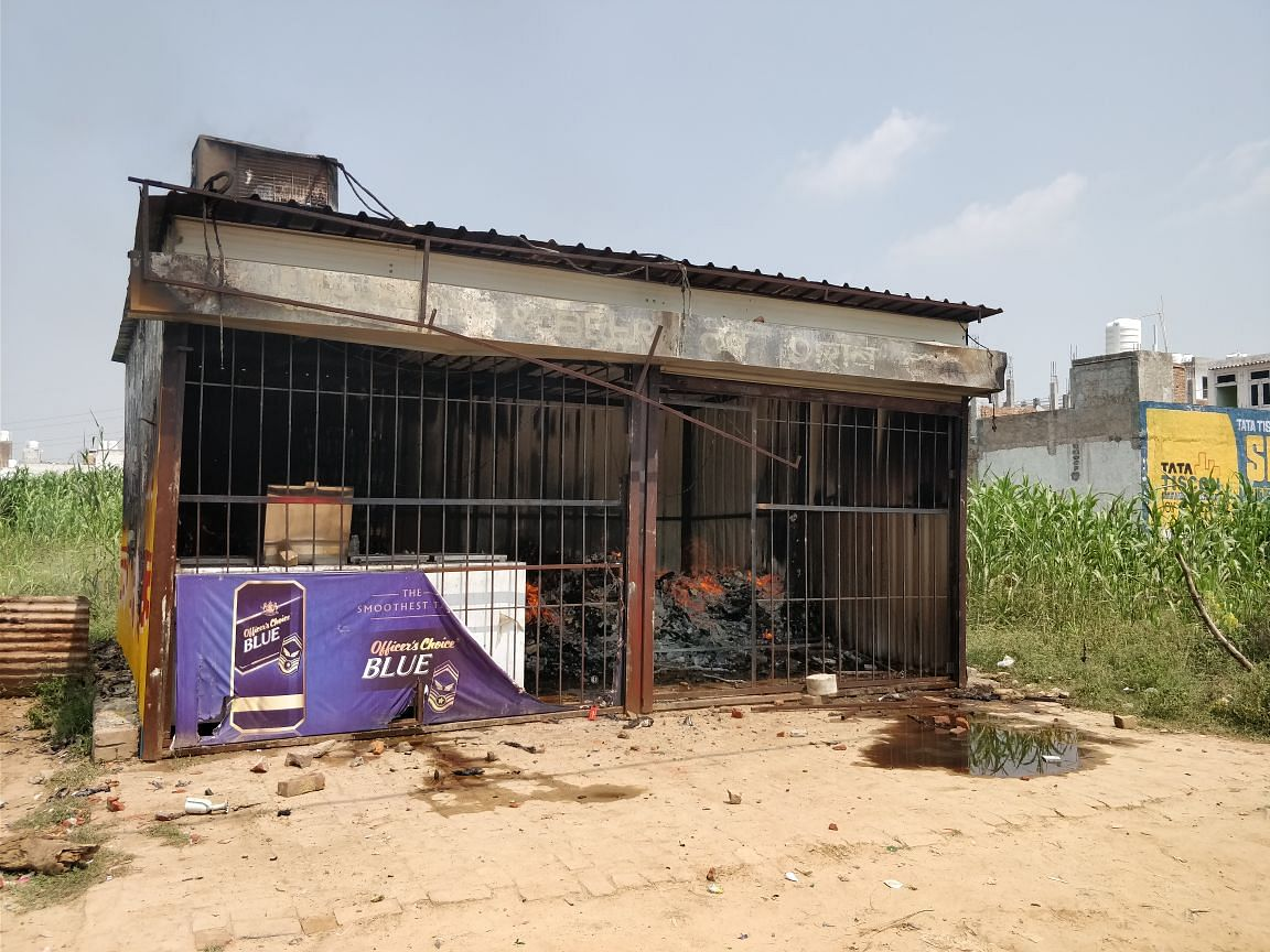 Angry parents burnt a liquor store down.
