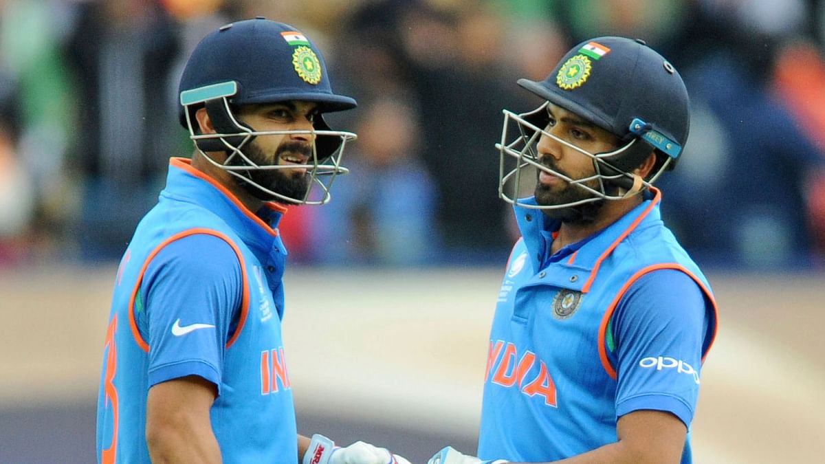 Virat Kohli (L) and Rohit Sharma (R) share a moment during a Champions Trophy match.