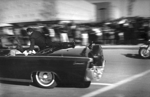 Limousine carrying mortally wounded President John F Kennedy races toward the hospital seconds after he was shot in Dallas.