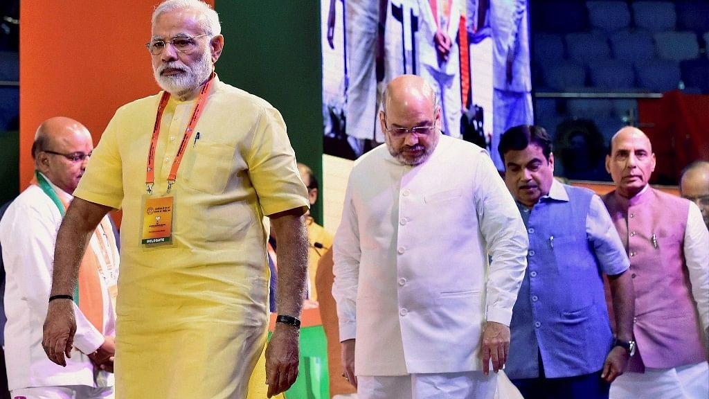 Prime Minister Narendra Modi with BJP President Amit Shah and Union Ministers Niti Gadkari and Rajnath Singh at BJPs national executive meeting at Talkatora stadium, in New Delhi on Monday.