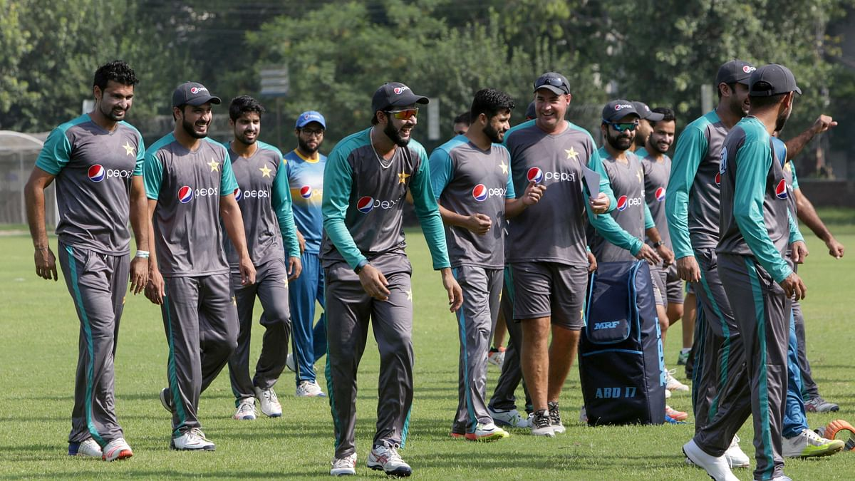 Pakistani cricketer Imad Wasim, centre, shares a joke with teammates, while they attend a training session for the upcoming World XI series at a ground in Lahore, Pakistan, Sunday, Sept. 10, 2017