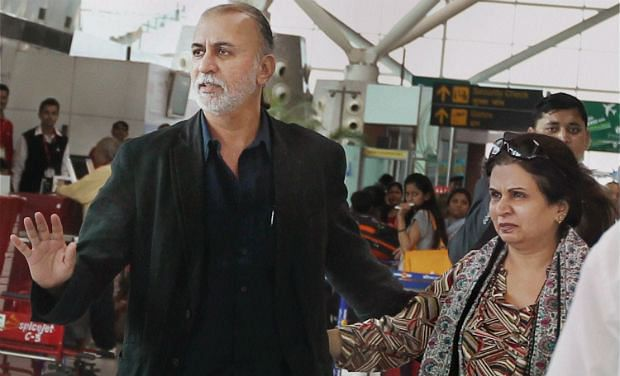 Tarun tejpal arrives at the Delhi airport to leave for Goa on 29 November 2013.