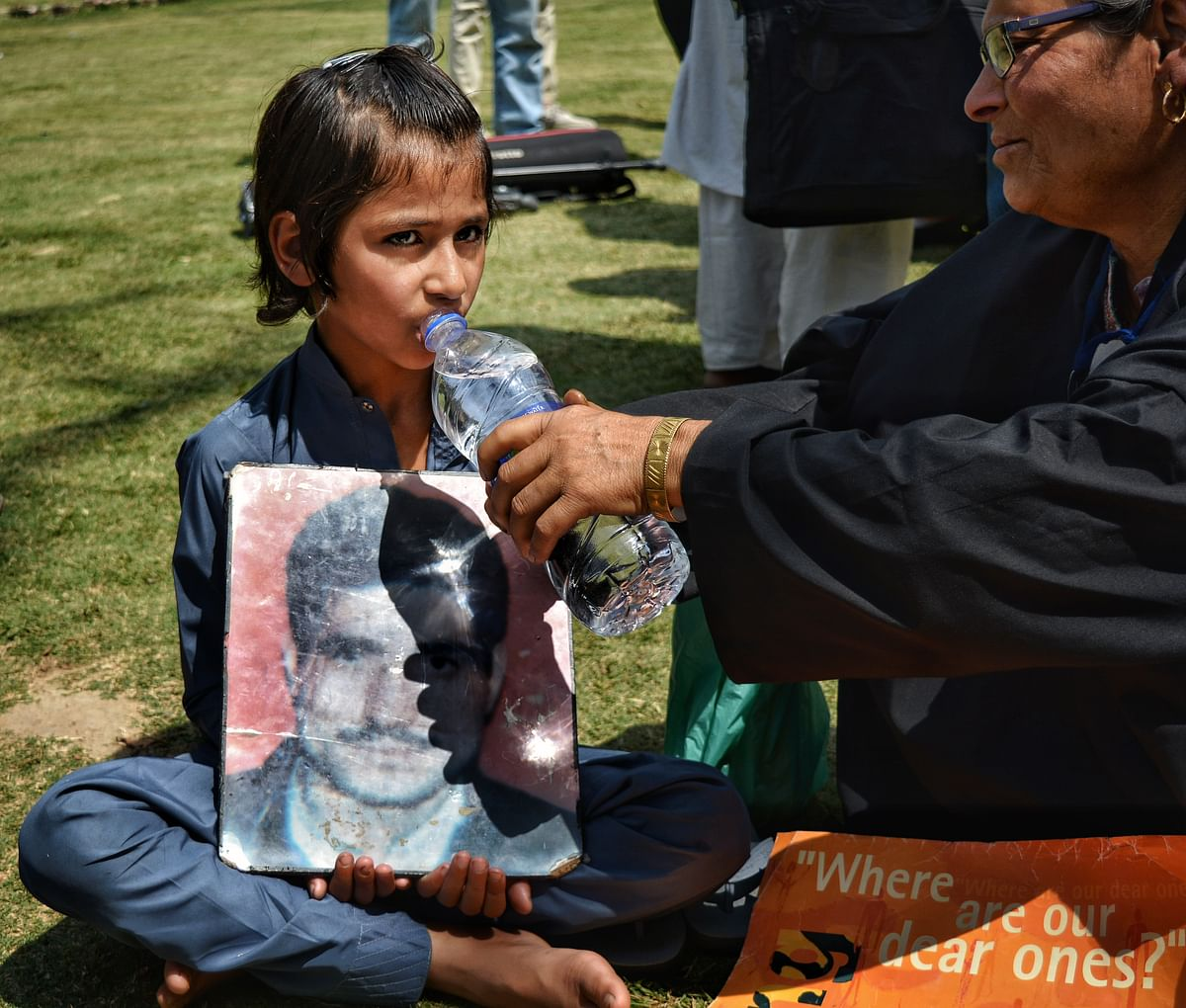 A child at a demonstration organised by the APDP.