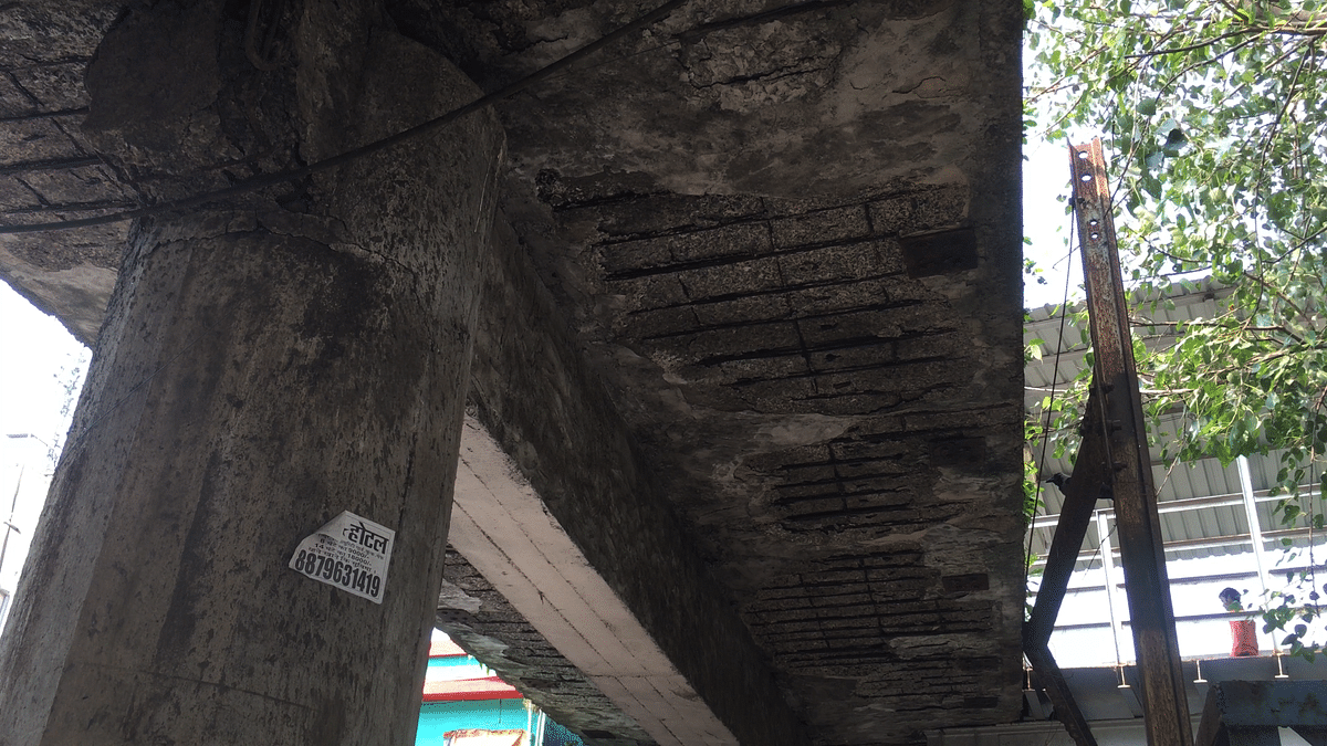 The underside of a dilapidated  foot-over-bridge at Malad station.