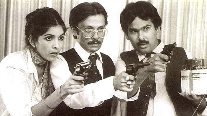 Neena Gupta, Pankaj Kapoor and Satish Kaushik in a scene from Kundan Shah's <i>Jaane Bhi Do Yaaro.</i>