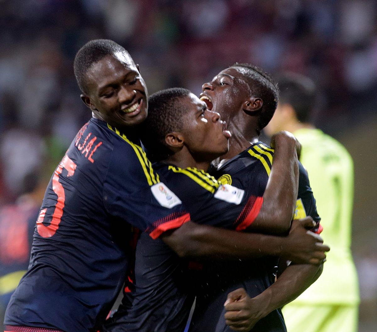 Colombia's Deiber Caicedo (C) celebrates with his teammates after scoring a goal.