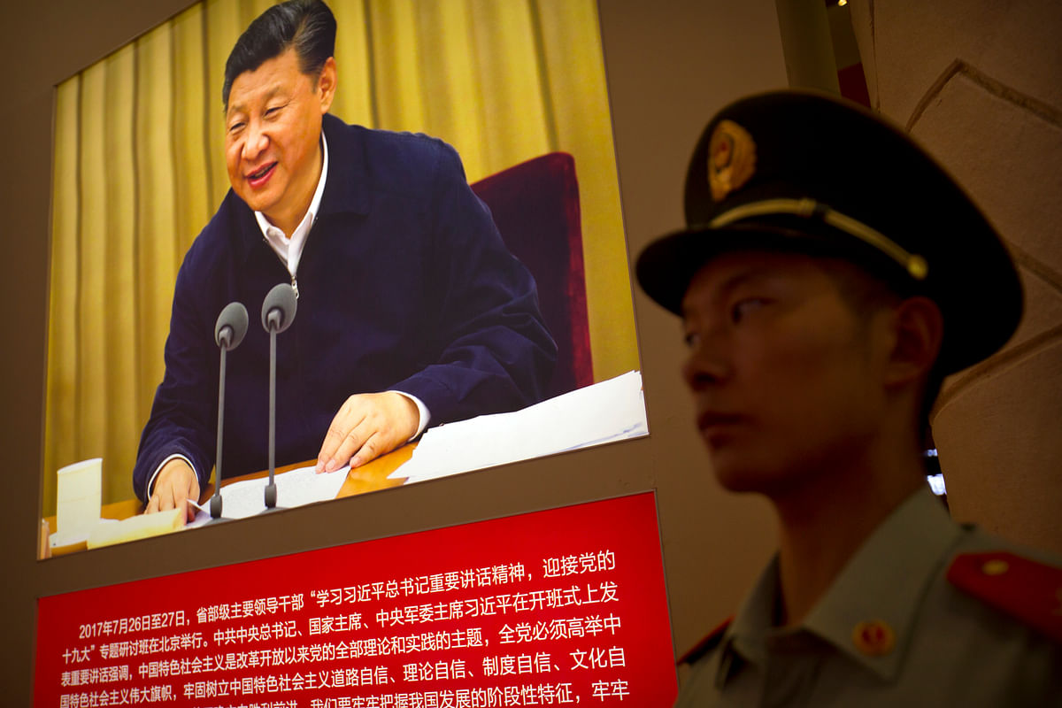 A Chinese paramilitary policeman stands guard at an exhibition highlighting China's achievements under five years of leadership by President Xi Jinping at the Beijing Exhibition Hall. <i>(Photo: AP)</i>
