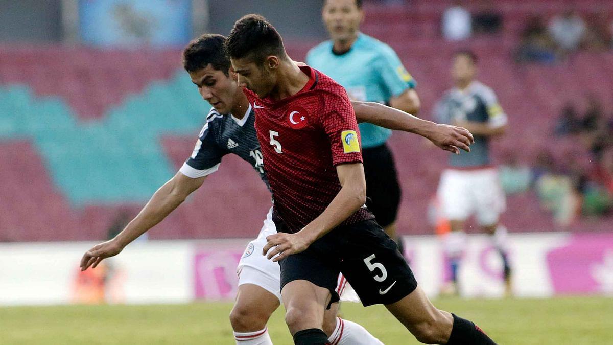 Turkey's Abdussamed Karnucu duels for the ball against Paraguay's Alexis Duarte.