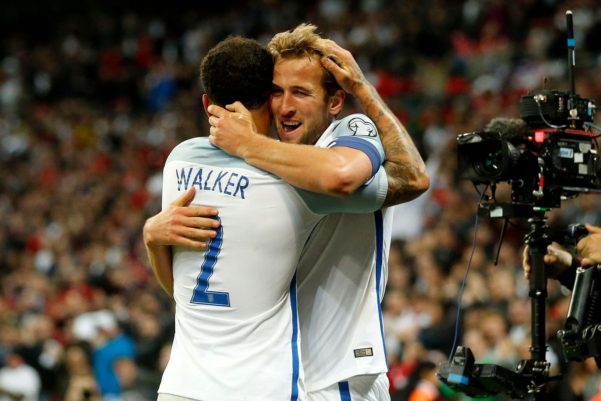 England's Kyle Walker, left, hugs the scorer Harry Kane during the World Cup Group F qualifying soccer match between England and Slovenia at Wembley stadium in London, Thursday, Oct. 5, 2017<a></a>