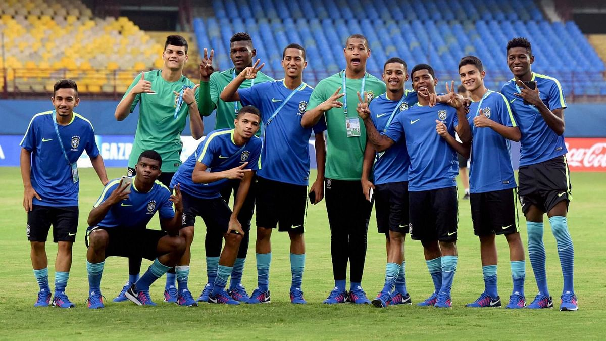 Kochi : FIFA U-17 World Cup football players of the Brazil team posing for photographs after visiting the Jawaharlal Nehru International Stadium in Kochi on Thursday.