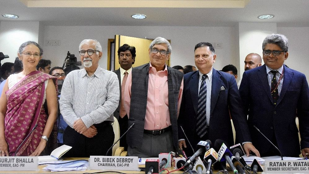Bibek Debroy, Chairman, Economic Advisory Council to the Prime Minister (EAC-PM) with members Ratan P Watal, Rathin Roy, Surjit Bhalla and Ashima Goyal during a press conference in New Delhi on Wednesday.
