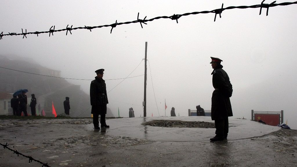 Chinese soldiers guard the border at Nathu La Pass.