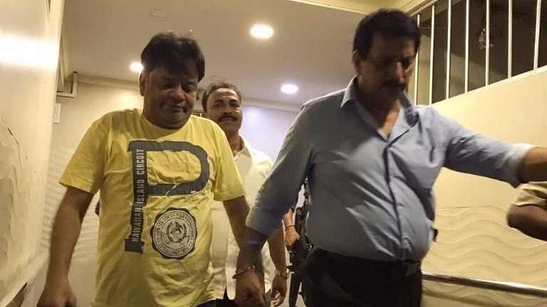 Dawood Ibrahim's brother Iqbal Kaskar (left) being taken by the police.