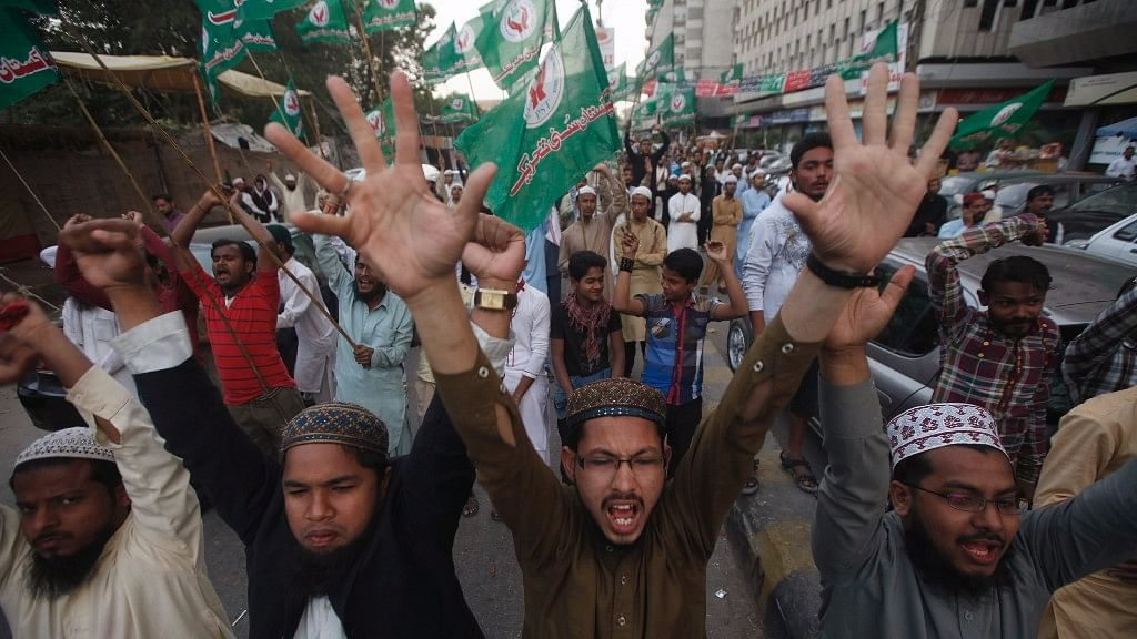 Protesters shout slogans during a demonstration against the sentence of convicted killer Mumtaz Qadri in Karachi in 2015. Qadri was convicted for killing Pakistani Governor Salman Taseer for supporting the repeal of the country's blasphemy laws. Image used for representational purposes.