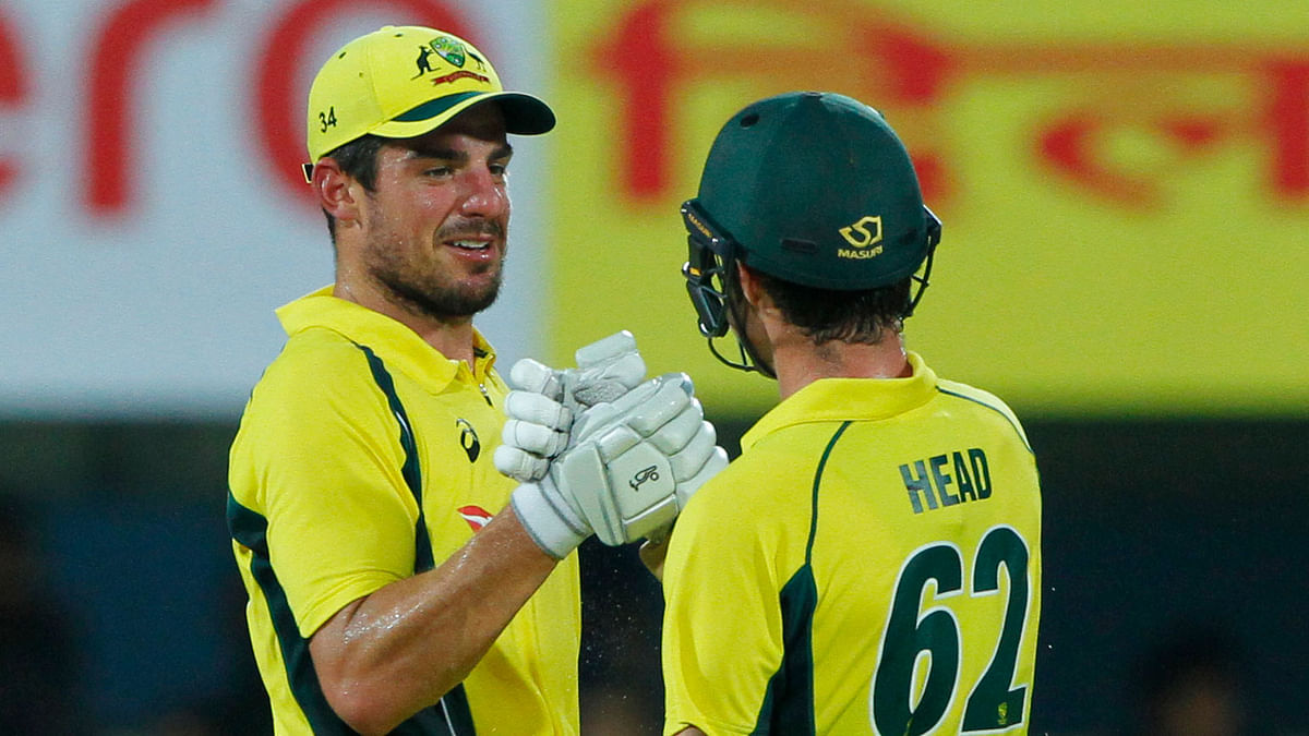 Moises Henriques celebrates with Travis Head after Australia beat India by 8 wickets.