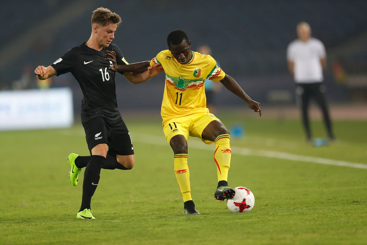 Mali's Mamadou Traore duels with the ball against New Zealand's Oliver Whyte.